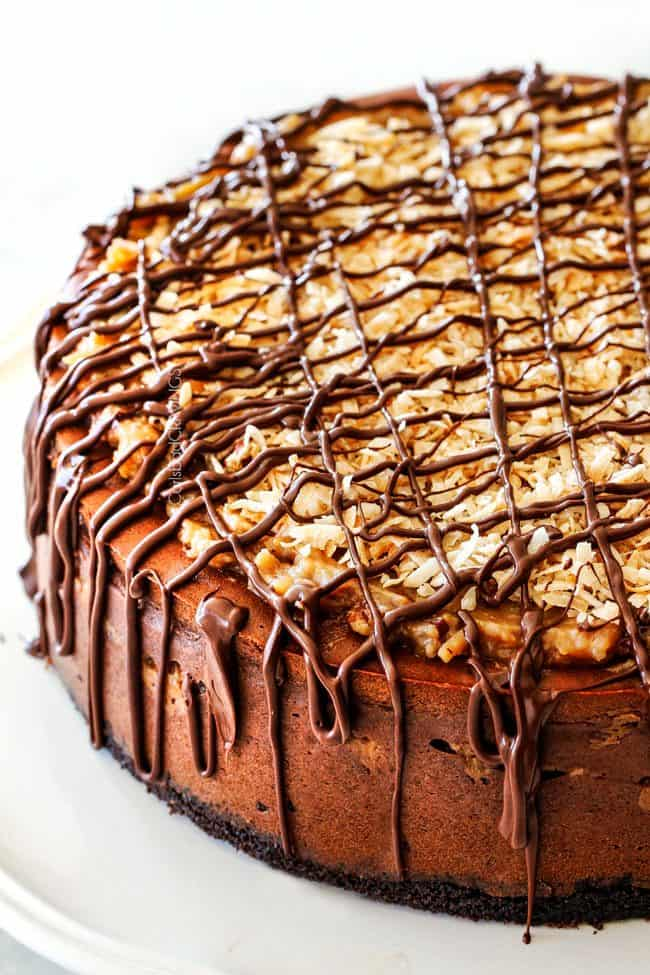 Show stopping German Chocolate Cheesecake AKA the best German Chocolate anything! The rich and creamy chocolate cheesecake is stuffed with a hidden layer of caramely Coconut Pecan Frosting and another layer on top!