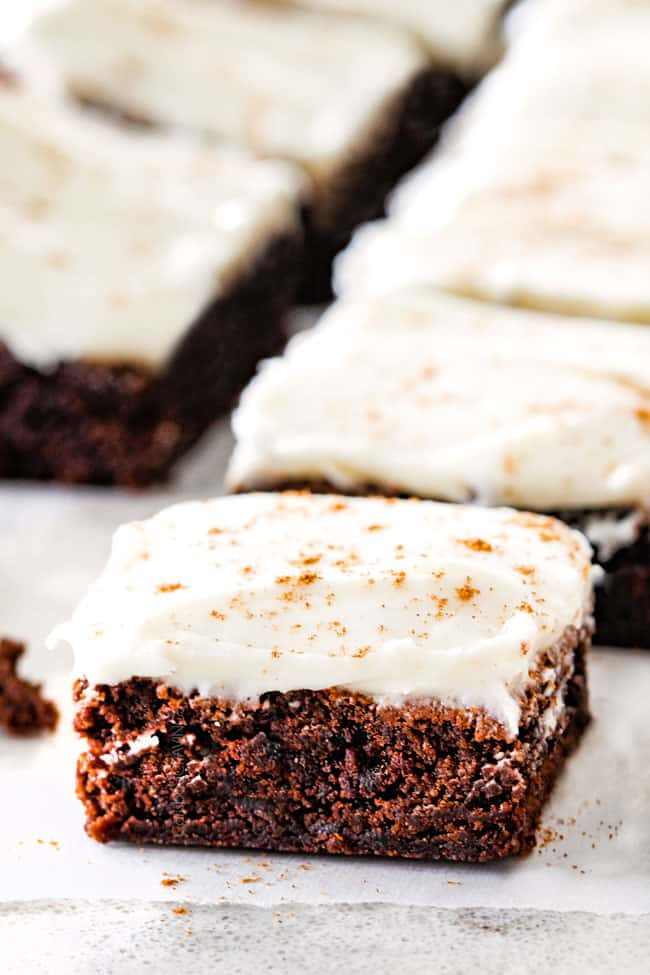Soft and chewy Gingerbread Brownies are your favorite holiday cookie in rich chocolate brownie form all smothered in luscious Eggnog Cream Cheese Frosting!  These are destined to become a must make holiday favorite and so much easier than rolling/baking individual cookies!