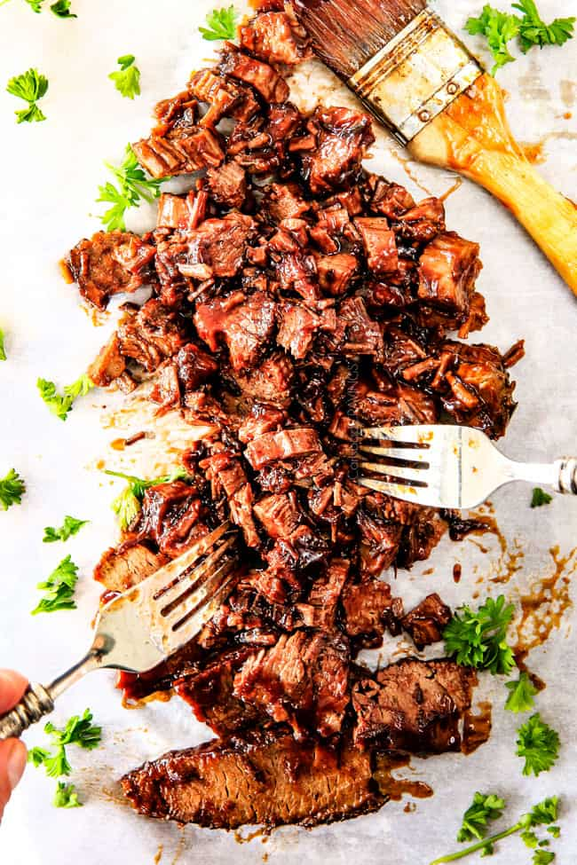 "Slow Cooker Beef Brisket is my favorite meat dish EVER and ""better than any restaurant"" according to my food critic husband!   It's the ultimate easy company dinner because it can be made days in advance then reheated in the slow cooker for stress free entertaining!"