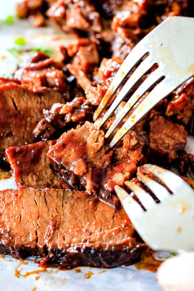 "Slow Cooker Beef Brisket wonderfully juicy, flavor exploding, melt-in-your-mouth and is my favorite meat dish EVER and ""better than any restaurant"" according to my food critic husband!   It's the ultimate easy company dinner because it can be made days in advance then reheated in the slow cooker for stress free entertaining!"