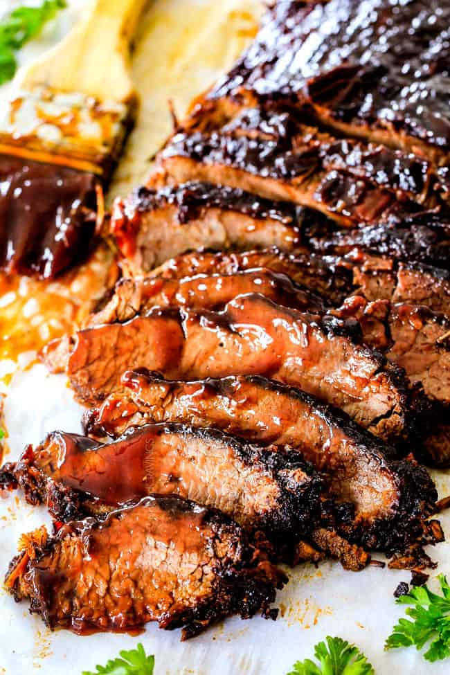 "Wonderfully juicy, flavor exploding, melt-in-your-mouth Slow Cooker Beef Brisket is my favorite meat dish EVER and ""better than any restaurant"" according to my food critic husband!   It's the ultimate easy company dinner because it can be made days in advance then reheated in the slow cooker for stress free entertaining!"