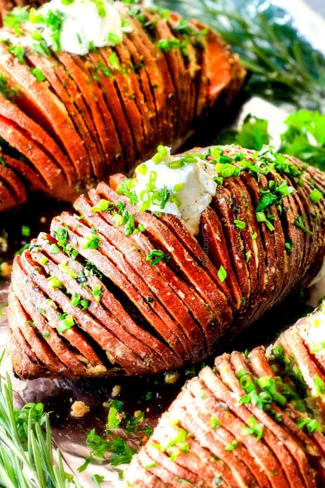 These Hasselback Sweet Potatoes are tender, melt-in-your-mouth and bursting with garlic herb, butter flavor! They look wonderfully gourmet for holidays and special occasions but are everyday easy!