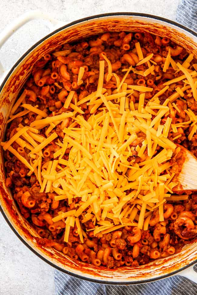 Adding cheese to One Pot Chili Mac and Cheese.