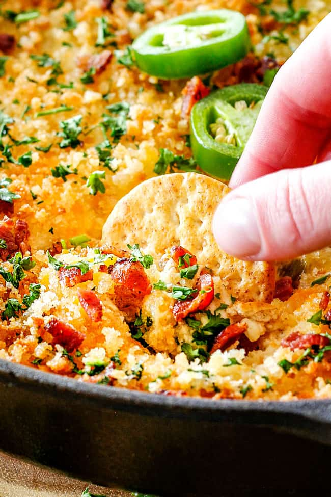This quick and easy Jalapeno Popper Dip with sour cream tastes like your favorite appetizer in EASY, warm, creamy, cheesy addicting dip form!  It is my go-to party appetizer that everyone LOVES!!!