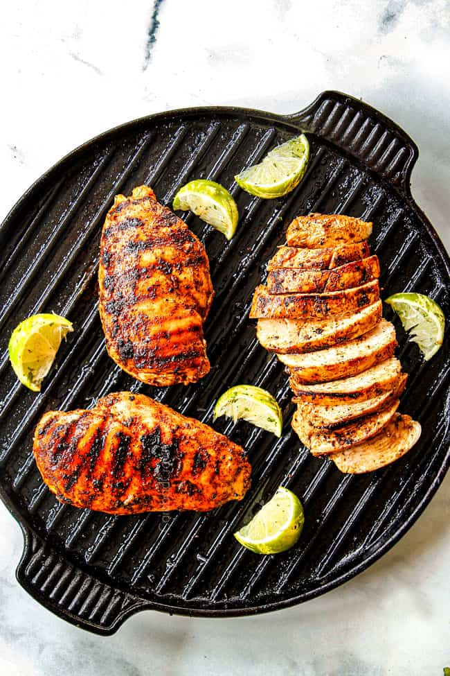 top view of showing how to cook chili lime chicken with three chicken breasts with grill marks on an indoor griill pan