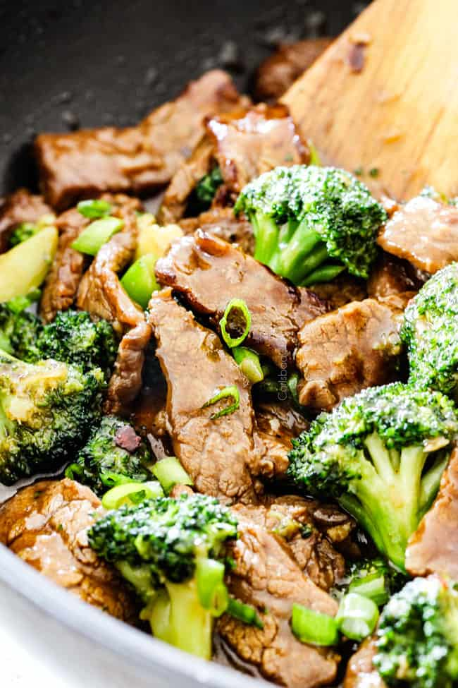 side view of Chinese beef and broccoli in a black skillet