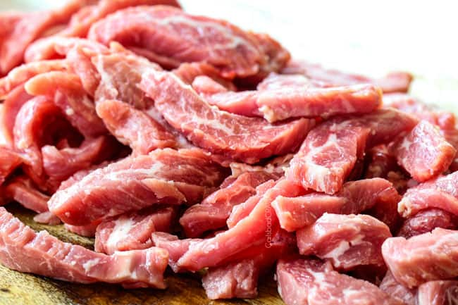 showing how to make Mongolian beef by slicing flank steak thinly across the grain