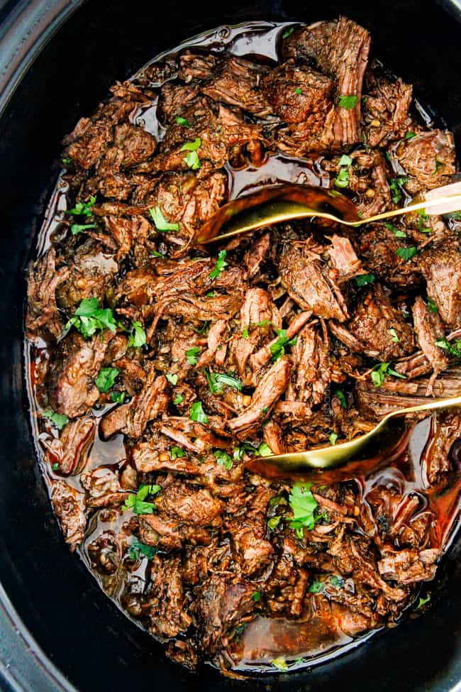 This is the BEST Slow Cooker Barbacoa Beef I have ever tried!  Super tender, juicy, EASY and bursting with rich, complex flavors!  Great for large crowds or make ahead meals and makes the best tacos, burritos, nachos, salads, etc!