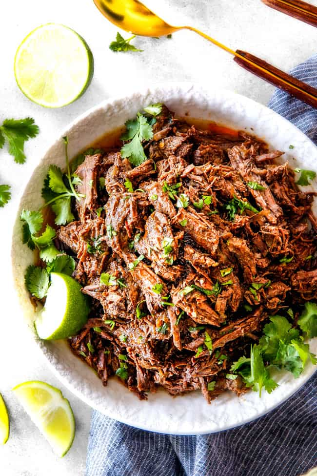 Chipotle Beef Barbacoa in a white bowl with parsley.