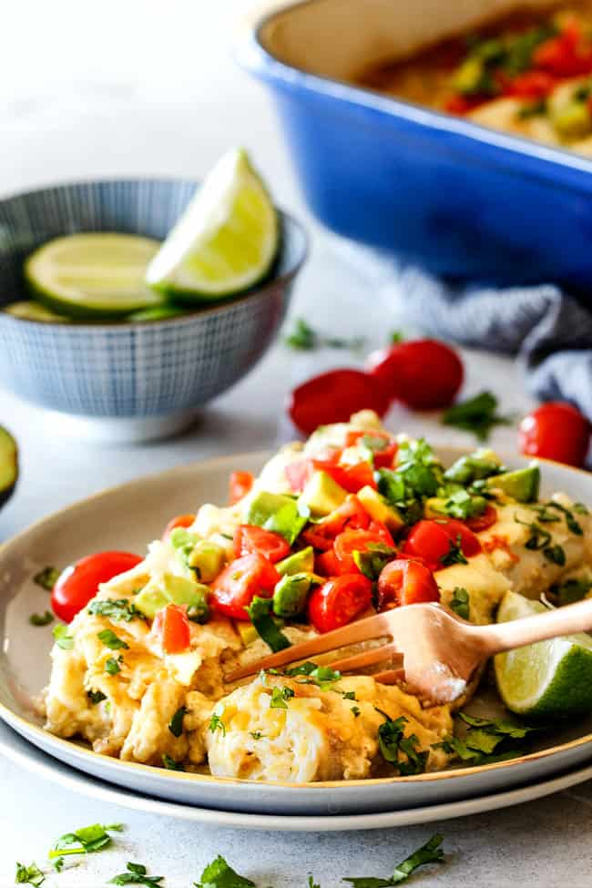 These are the BEST Green Chile Chicken Enchiladas I have ever had!!!  They are easy to make, satisfyingly rich, cheesy, creamy and saucy - no dry chicken enchiladas here! And the homemade green chile sour cream white sauce is out of this world!
