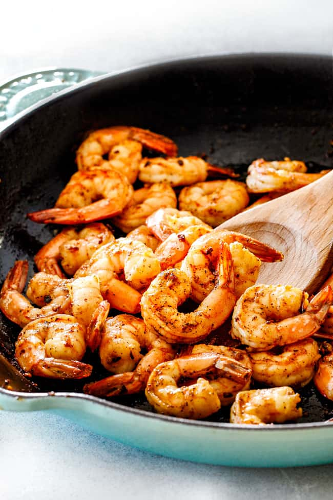 Cooking Lemon Butter Garlic Shrimp in a skillet