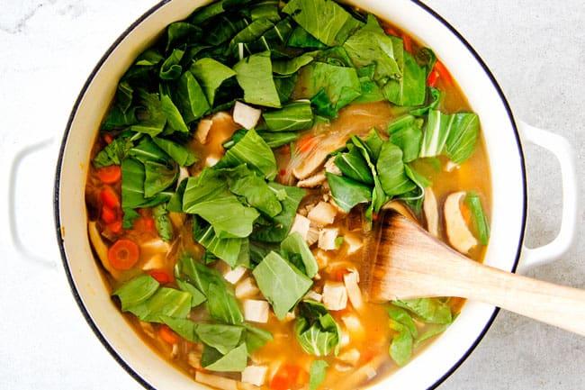Miso Soup adding vegetables.