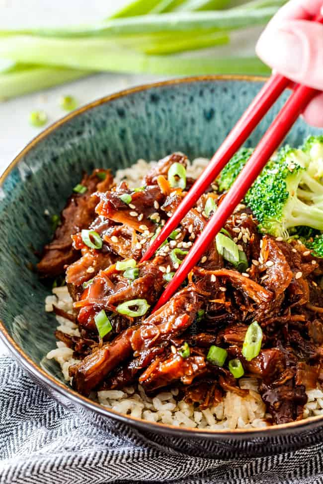 Eating Slow Cooker Pulled Pork In Green Bowl With Chopsticks