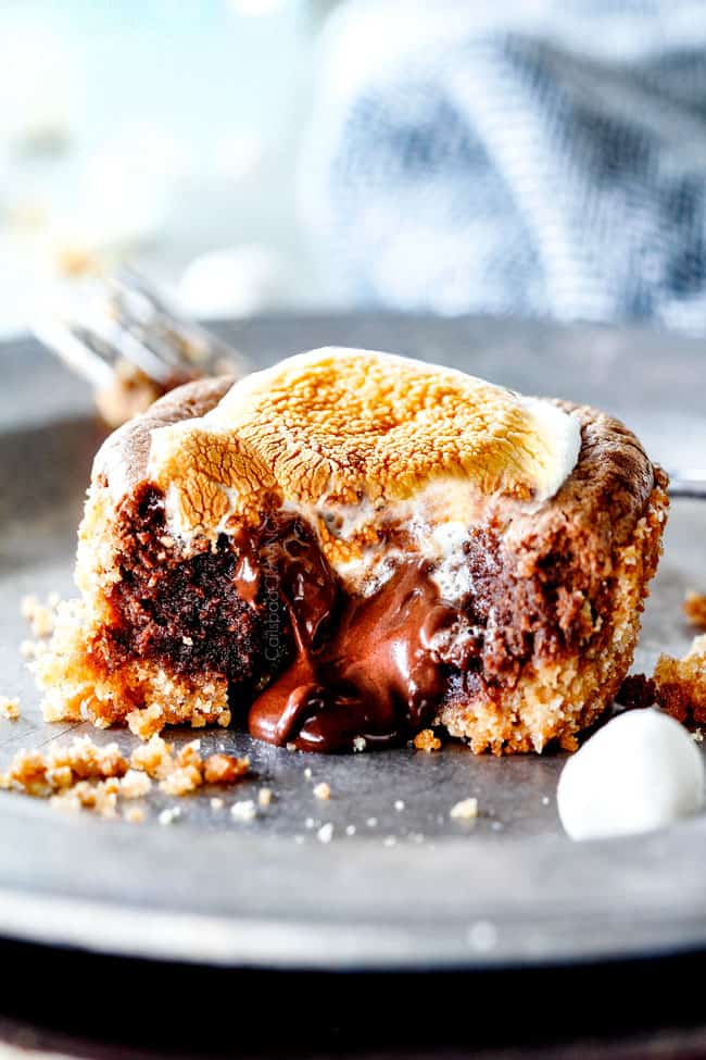 EASY - 30 Minute - S'mores Molten Lava Pies are decadently rich,with an oozing chocolate center, topped with melty toasted marshmallows all nestled in a buttery graham cracker crust - BUT - they are super easy to make and baked ina muffin tin so no special equipment is required!