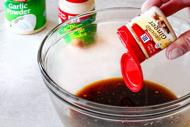 Making Honey Soy Marinade in a glass bowl