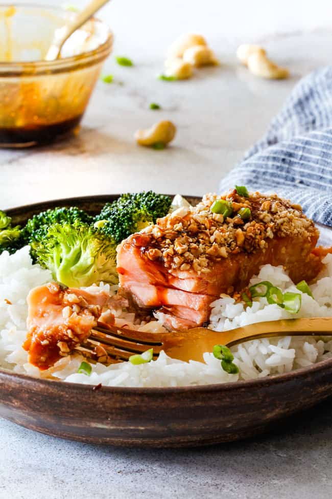 Cashew honey soy salmon with broccoli and rice in a brown bowl