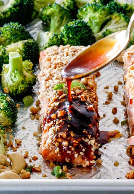 Drizzling honey soy glaze on Cashew Crusted Honey Soy Salmon