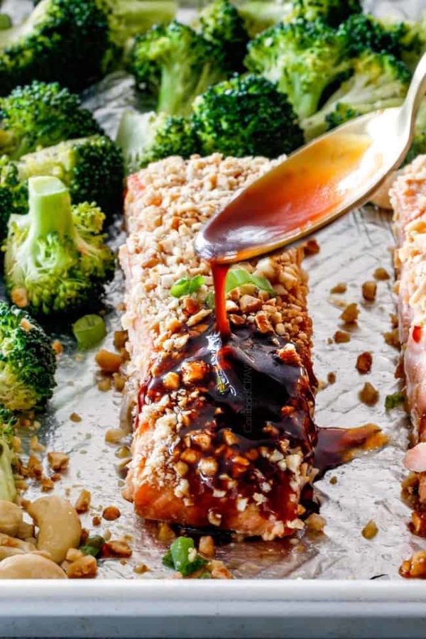 Drizzling honey soy glaze on Cashew Crusted Honey Soy Salmon