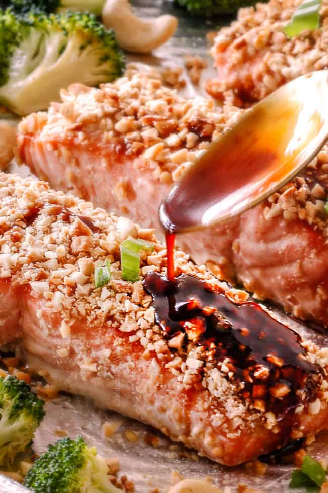 Honey Soy Salmon crusted in cashews with Honey Soy Glaze being drizzled on top