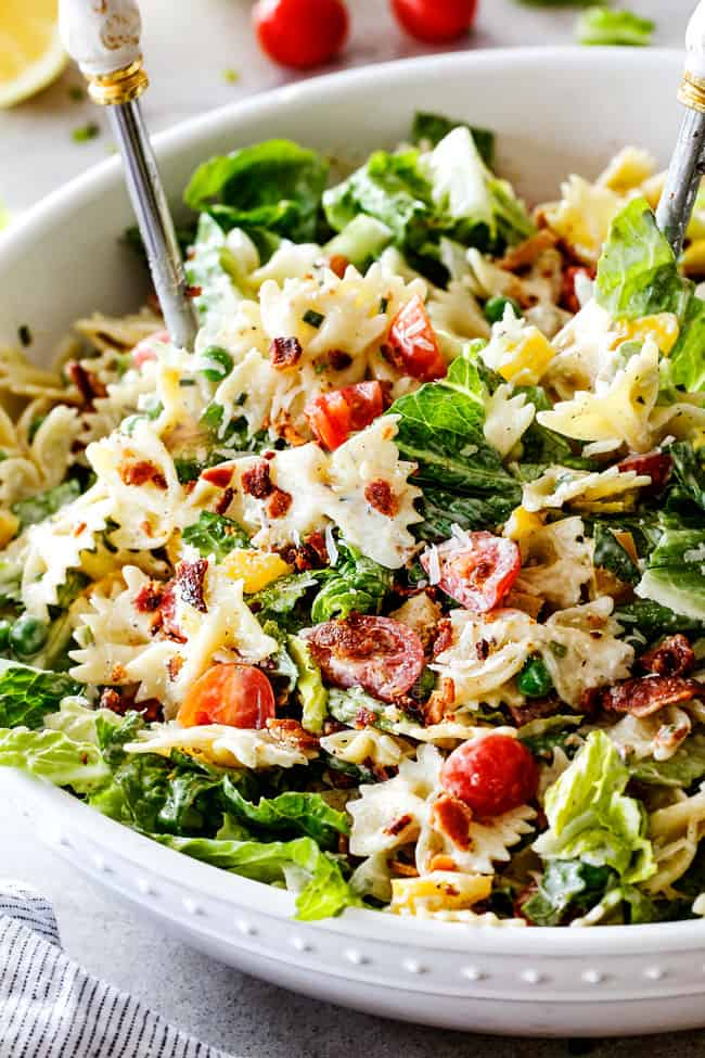 Up close side shot of easy BLT Pasta Salad recipe in a white bowl