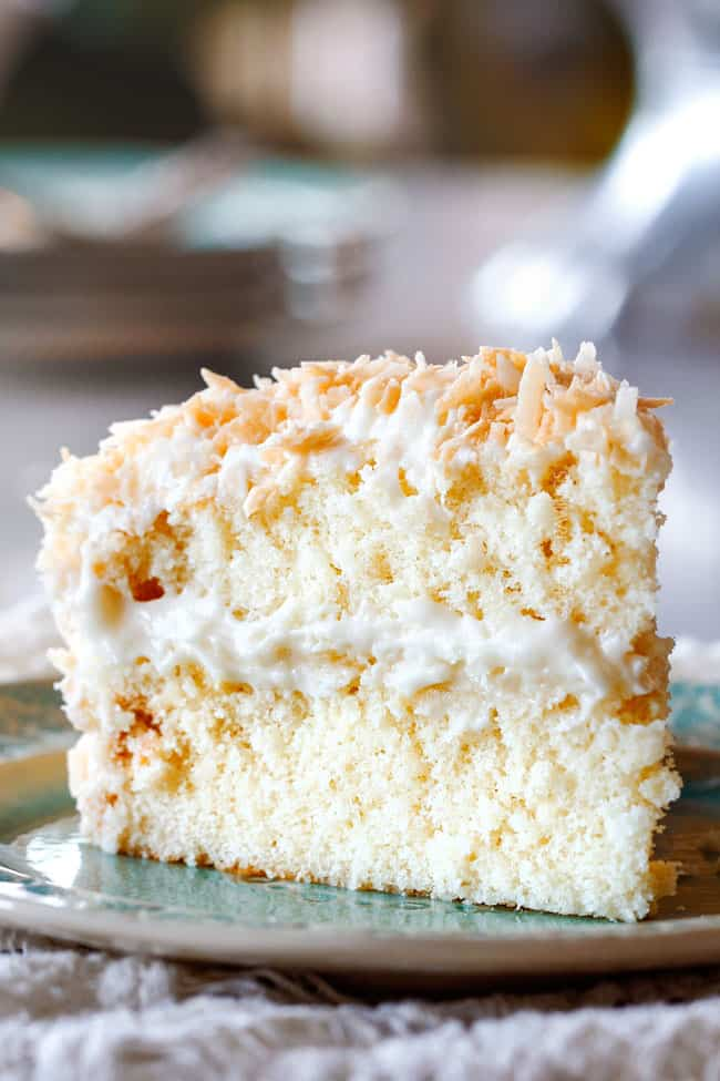 Best Coconut Cake on silver plate with a fork