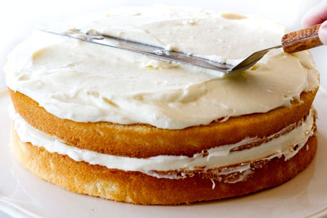 How to make simple Coconut Cake by frosting the top of the Cake with Coconut FRosting