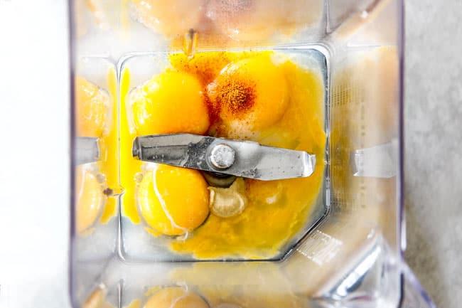 Showing how to make Blender Hollandaise Sauce by adding egg yolks, lemon juice, cayenne pepper and salt to blender