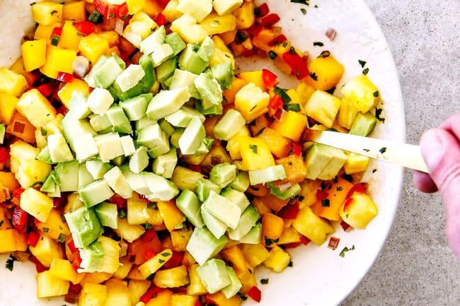 pineapple, mango, avocado salsa in a white bowl