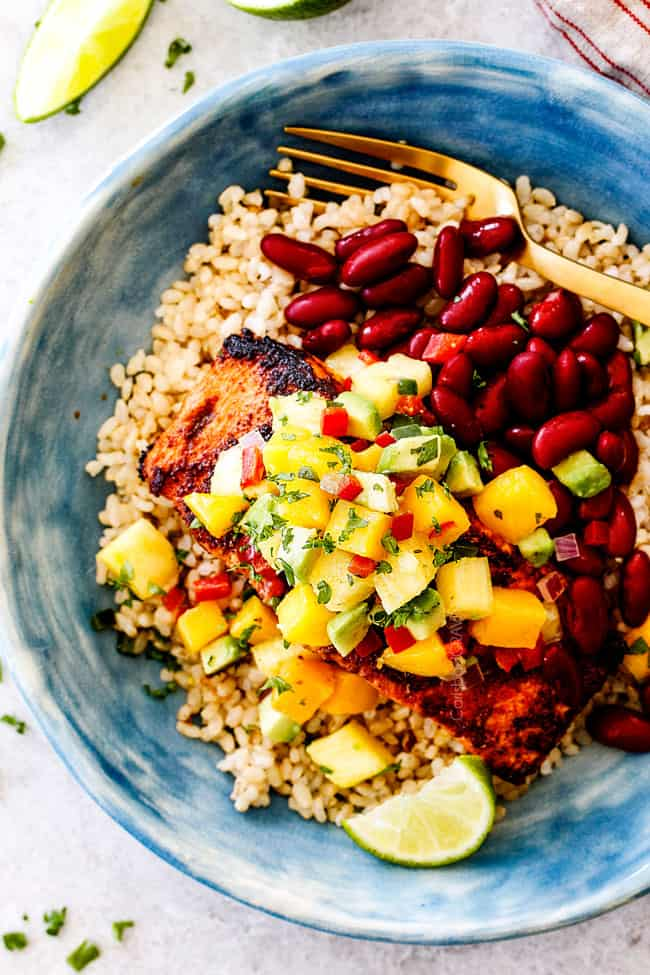 top view of cajun salmon with pineapple salsa, red beans and rice