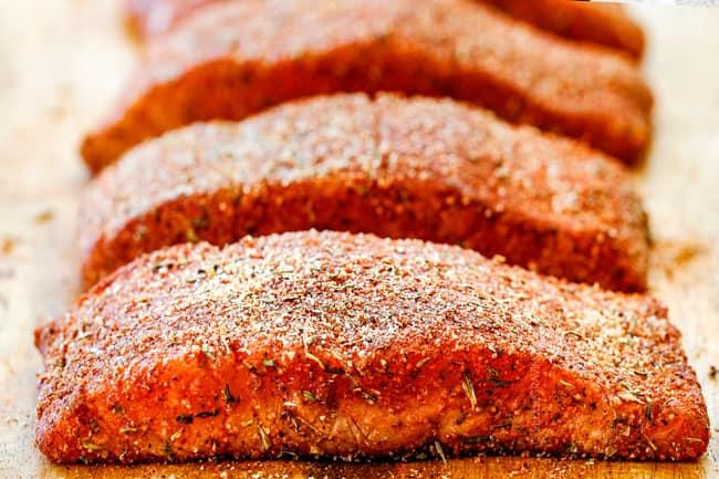 Cajun Salmon on a wood cutting board with homemade cajun seasoniong