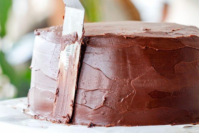 frosting moist Chocolate Raspberry Cake with ganache