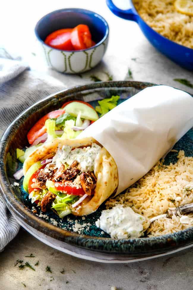 Greek Gyro with lemon rice and Greek salad on a blue plate