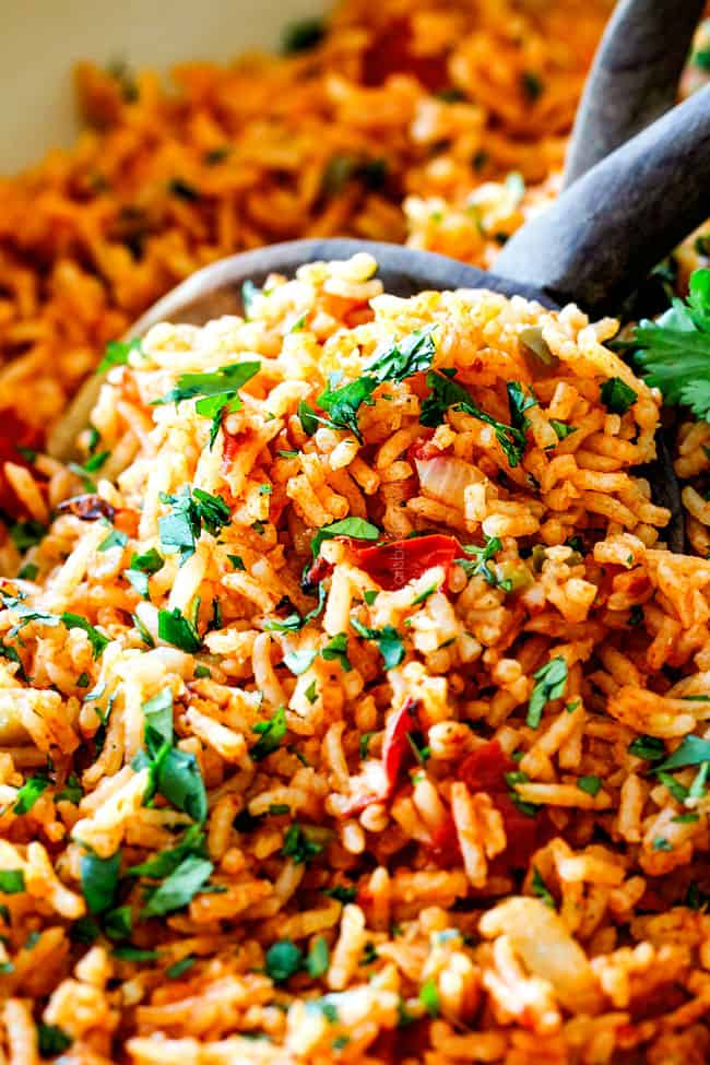 up close of easy Mexican rice in a wooden spoon