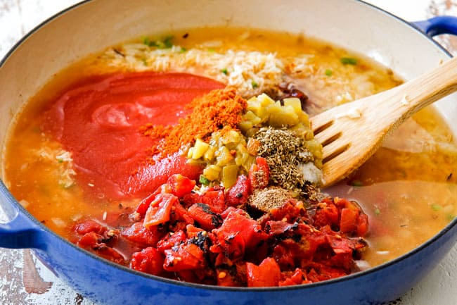 Showing how to make authentic Mexican Rice by Adding tomato sauce, fire roasted tomatoes, green cihles, chicken broth, ground cumin, peas, carrots, corn to rice