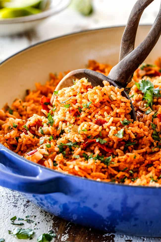 best Mexican Rice in a blue skillet with the optional peas, corn and carrots