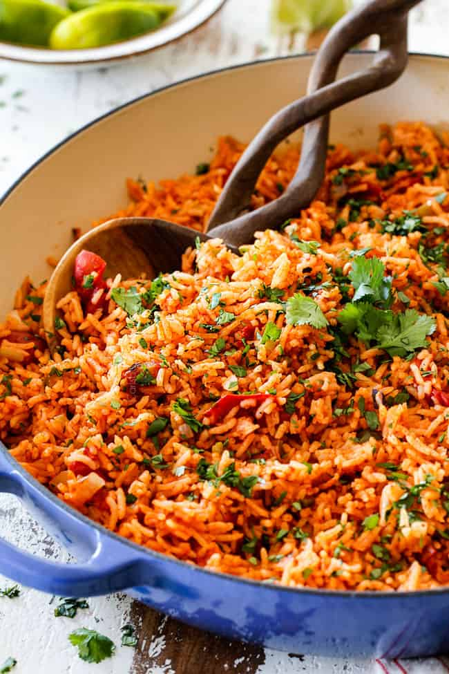authentic Mexican rice with fire roasted tomatoes in a blue skillet