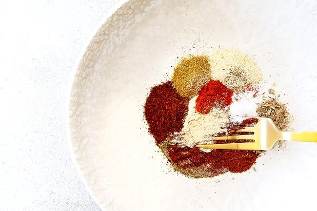 Showing how to make easy Shrimp Fajitas by mixing together homemade fajita seasoning in a white bowl