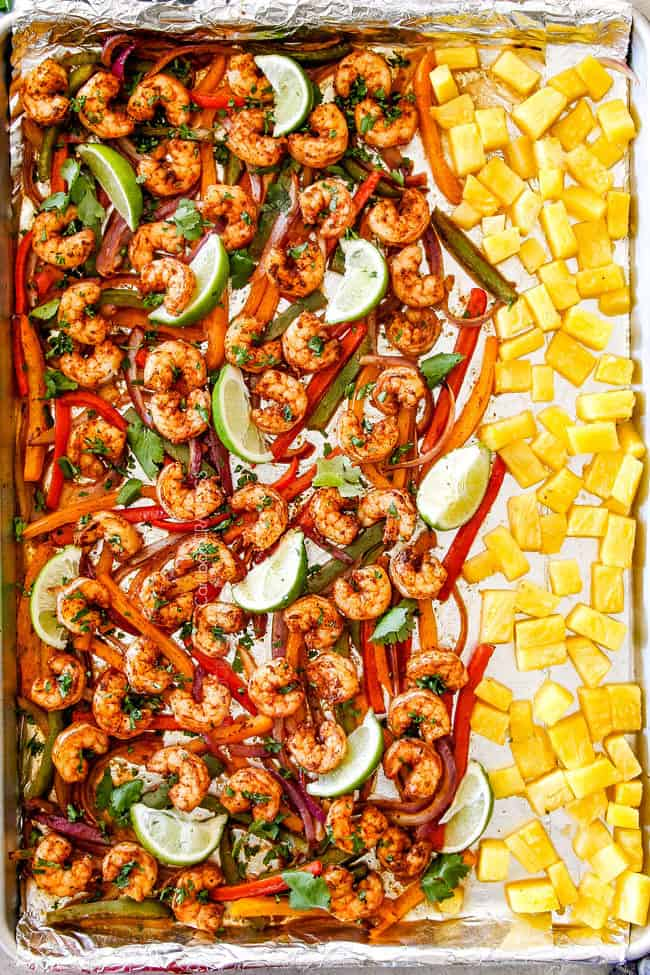 top view of shrimp fajitas in oven with rice, black beans, sour cream