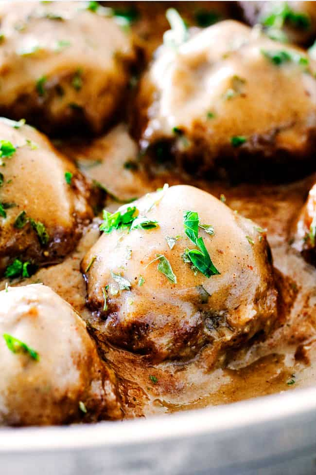 up close of Swedish Meatballs with sour cream in Swedish Meatball Sauce
