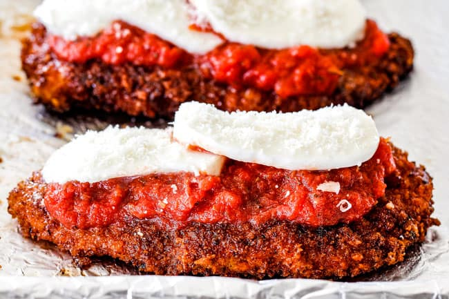showing how to make chicken Parmesan by layering fried chicken with tomato sauce, mozzarella and Parmesan