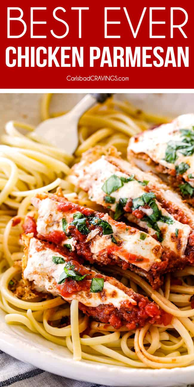up close of view of slices of baked chicken Parmesan with mozzarella cheese, Parmesan and fresh basil.