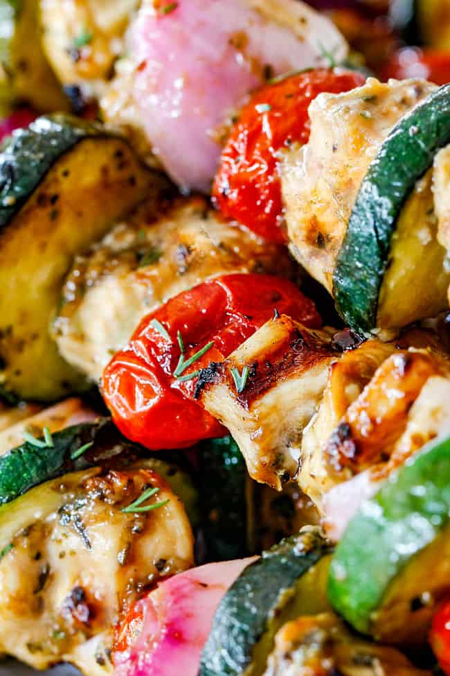 Chicken Souvlaki with tomatoes, chicken and zucchini on wooden skewers