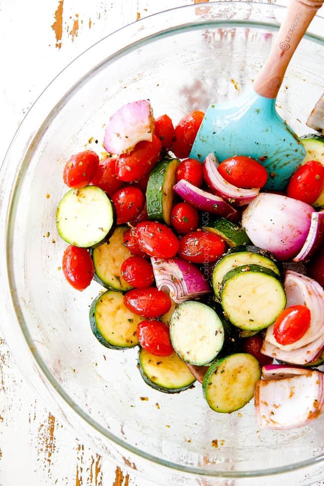 tomatoes, zucchini, onions in a glass bowl to make chicken souvlaki