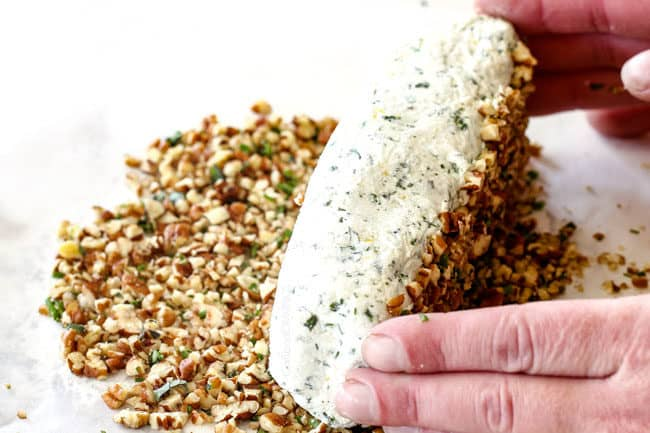 rolling cheese log in pecan mixture