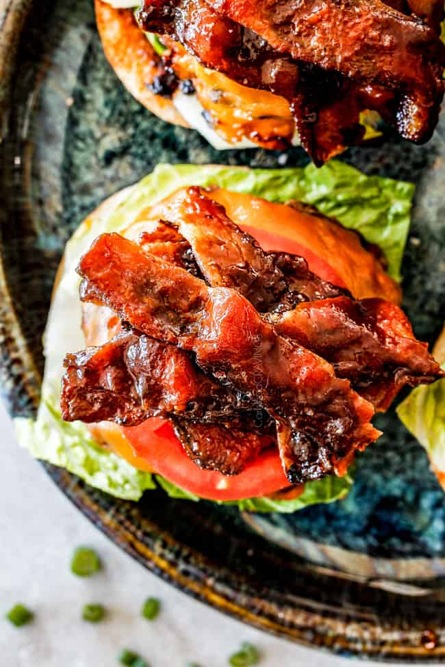 open faced bacon cheeseburger with lettuce and tomatoes