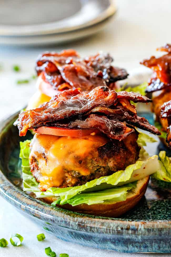 cheeseburger with bacon, lettuce and tomatoes open faced