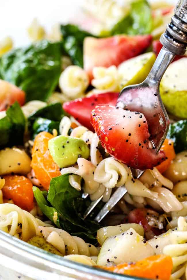 a forkful of strawberry avocado pasta salad