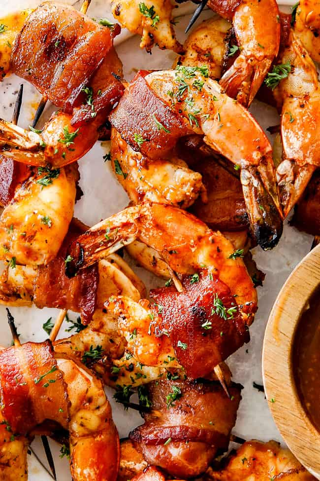top view of bacon wrapped shrimp on a white platter