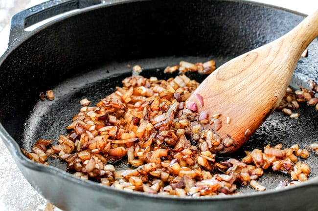 Showing How to make Homemade Baked Beans by cooking onions and garlic in a skillet