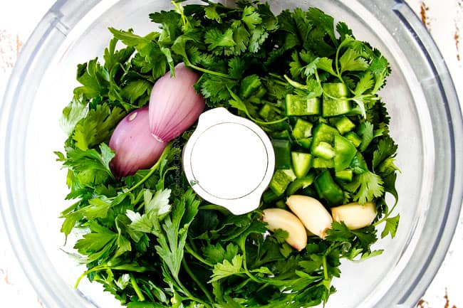 showing how to chop chimichurri for Chimichurri Steak by chopping parsley, cilantro, garlic shallot in food processor